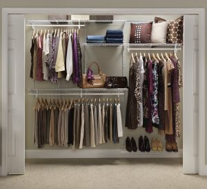 Sloped Ceiling Closet: White Ventilated Shelving