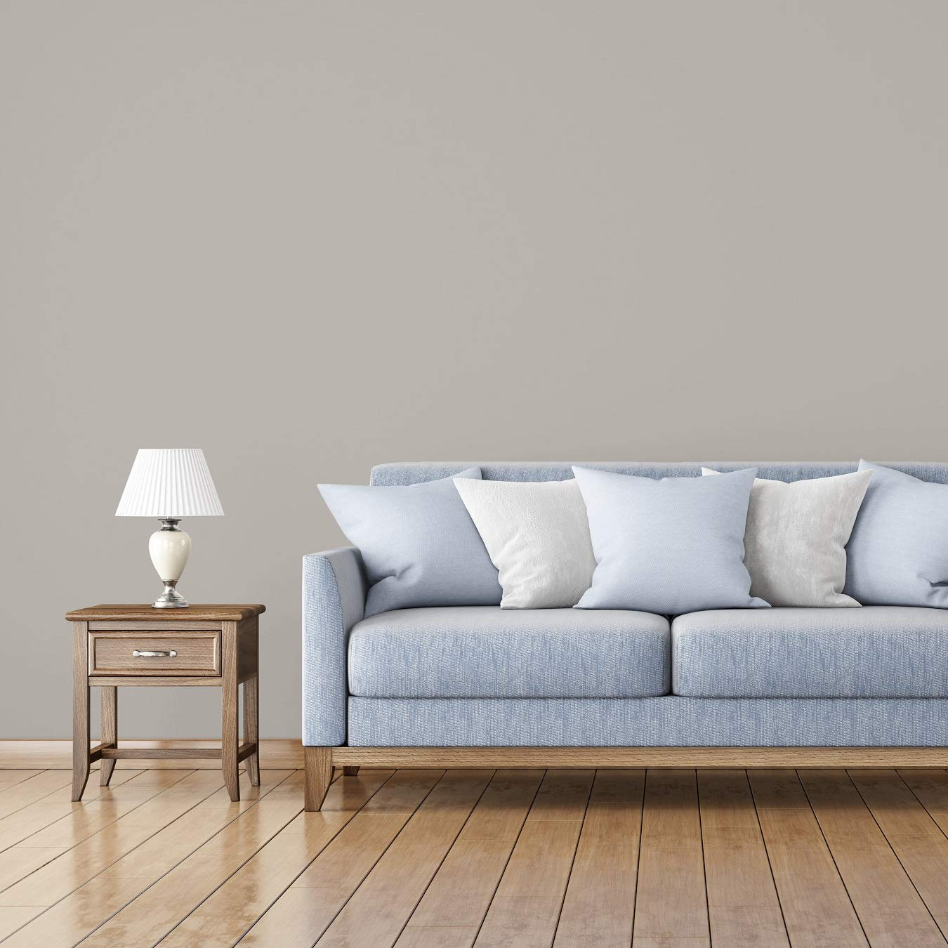 leather couch with lighter pillows and rug