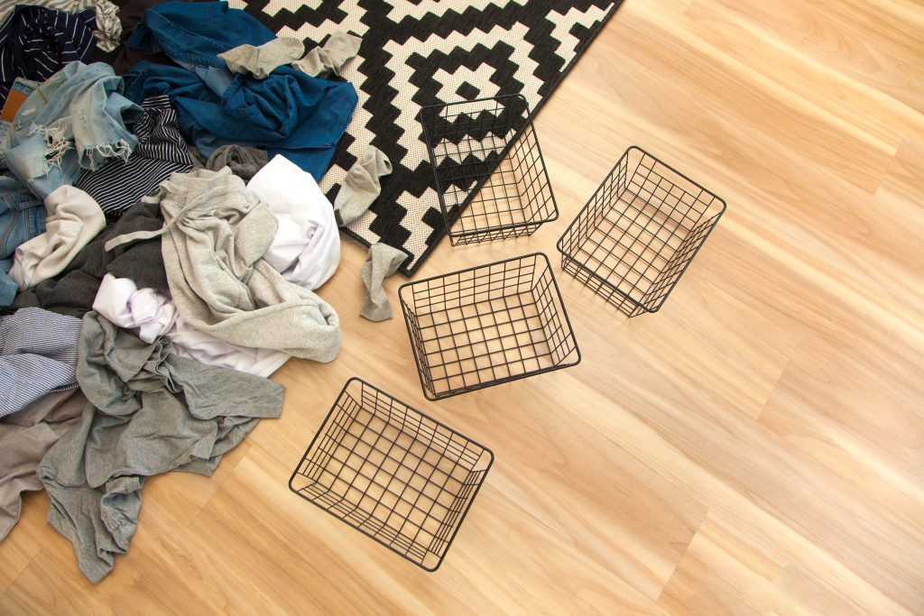 Clothes and basket Marie Kondo Tips on organizing