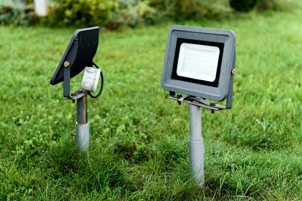 LED lawn lamp made of glass and metal on grass background.