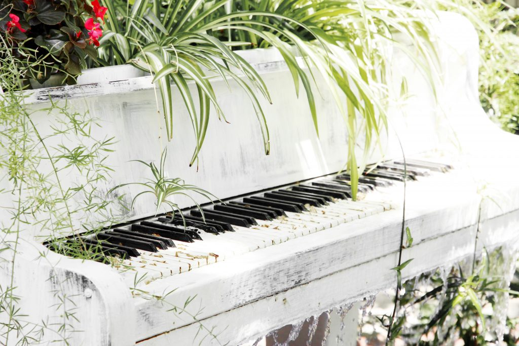 Piano fountain with plants in retro style
