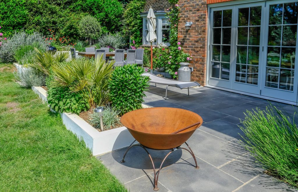 Modern contemporary patio in an English country garden.