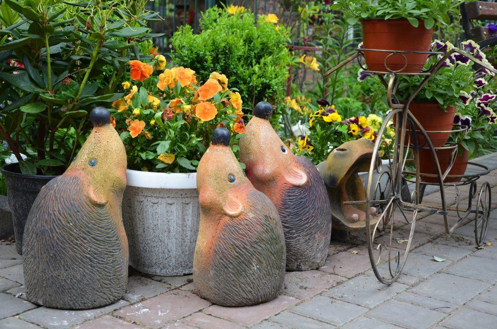 garden sculptures in the garden hedgehog figures flowers in the garden
