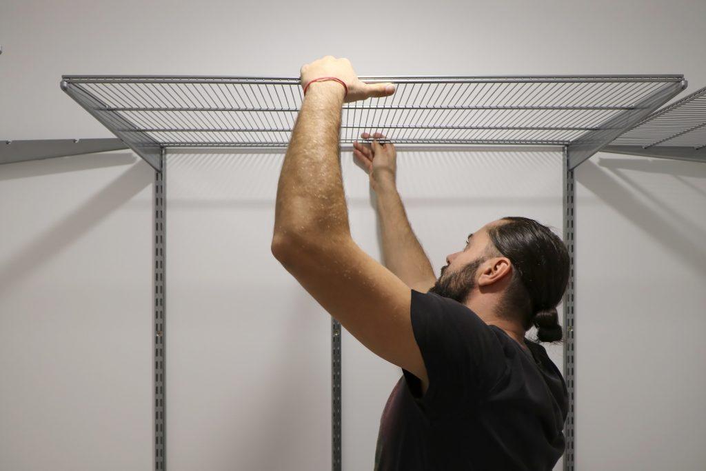 metal-shelf-installation-for-dvds