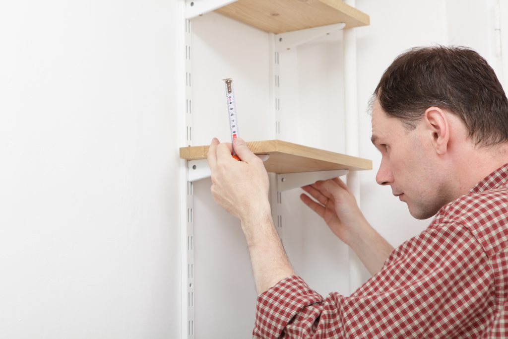 measuring and planning for installation of garage shelves