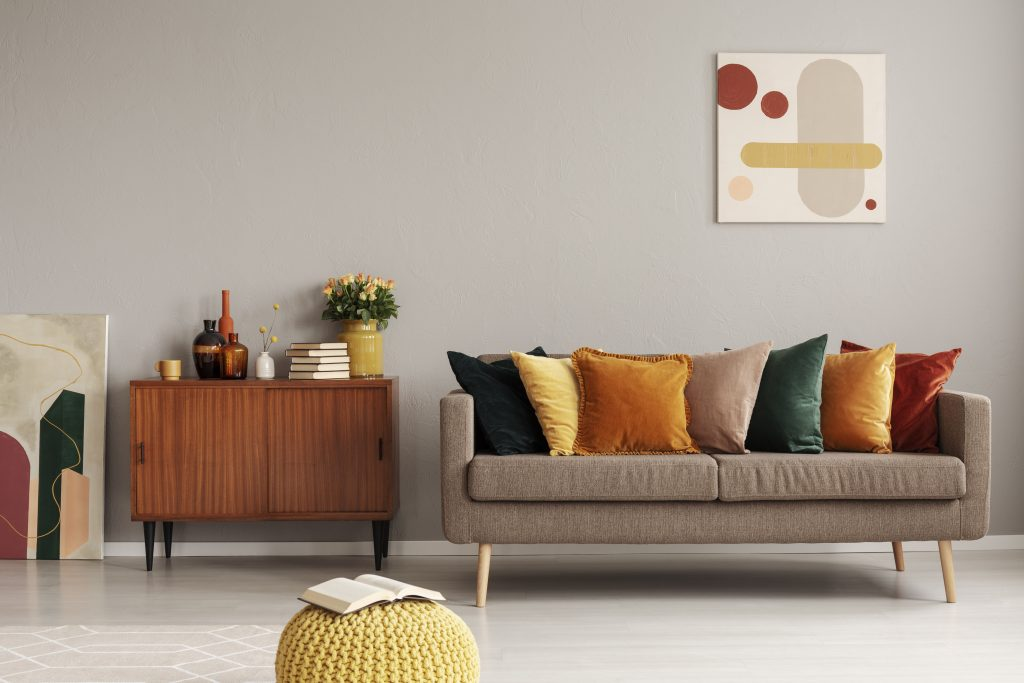 Retro style in beautiful living room interior with grey empty wall