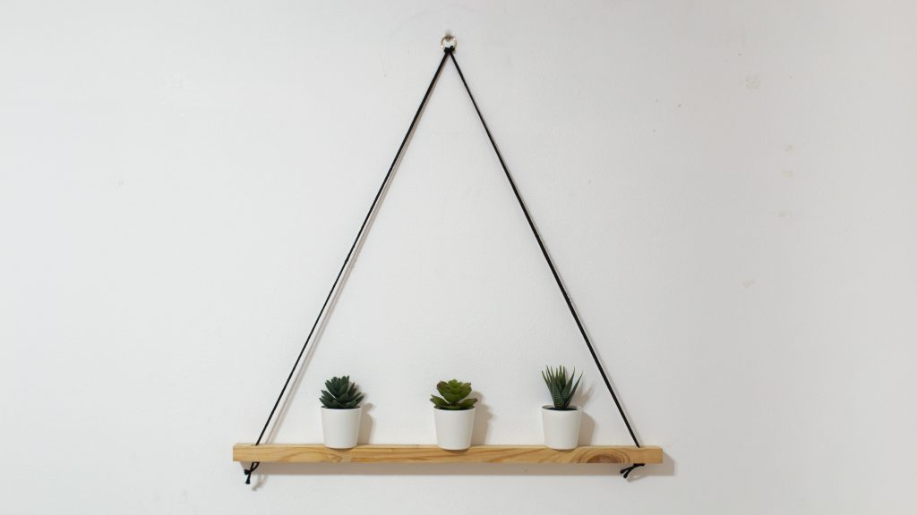Hanging rope shelf with fake plants