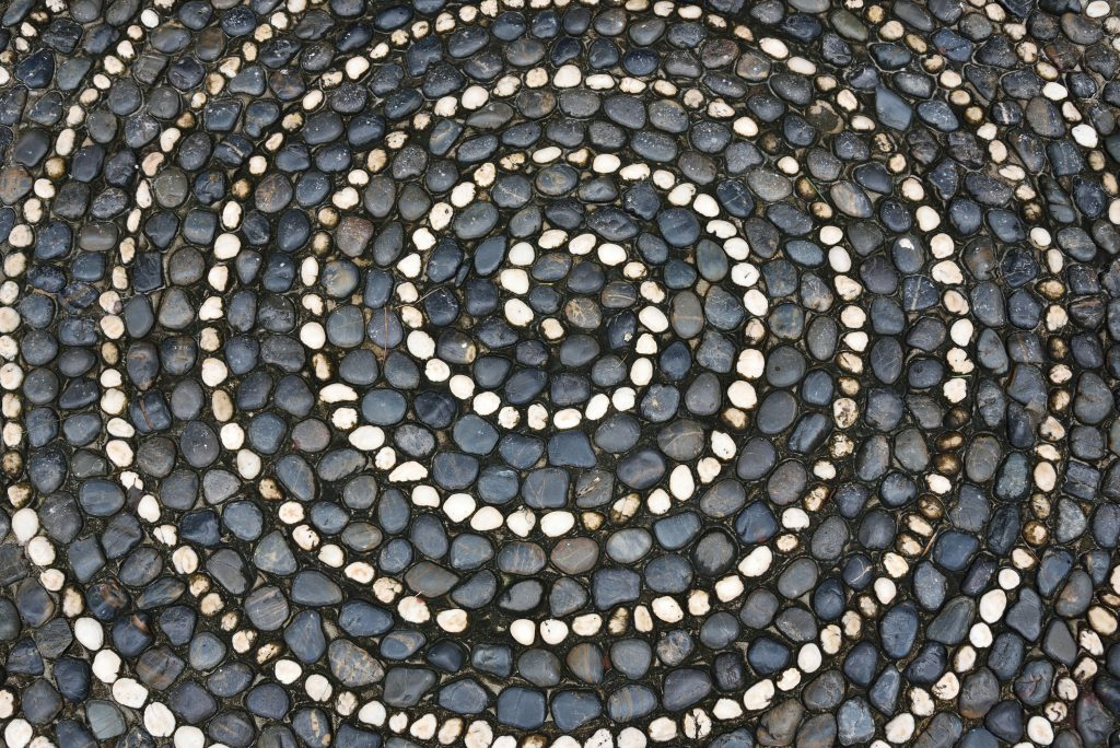 Pebbles mosaic floor with spiral pattern