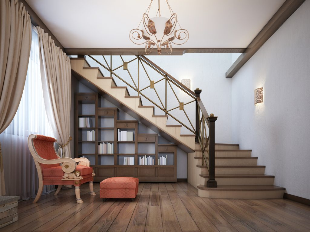 Library under the stairs with a red armchair in the English style.