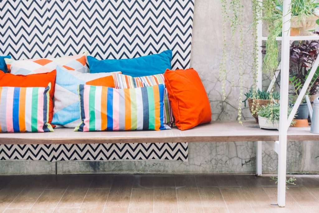 Colorful cushions on the balcony for a vintage feel