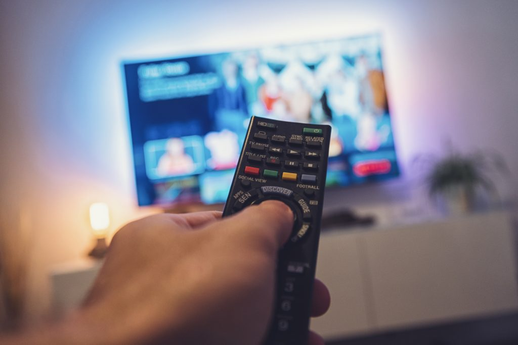 Hand pointing remote at the TV