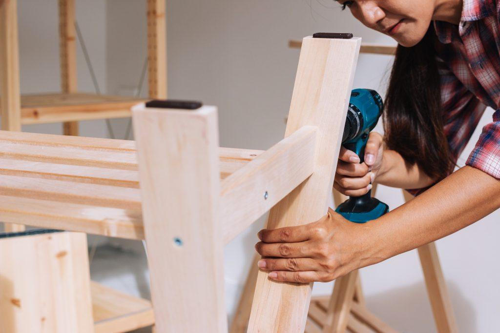 Woman worker in the carpenter workroom