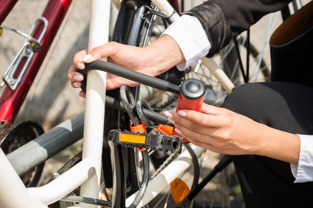 Businesswoman's Hand Locking Up Her Bicycle