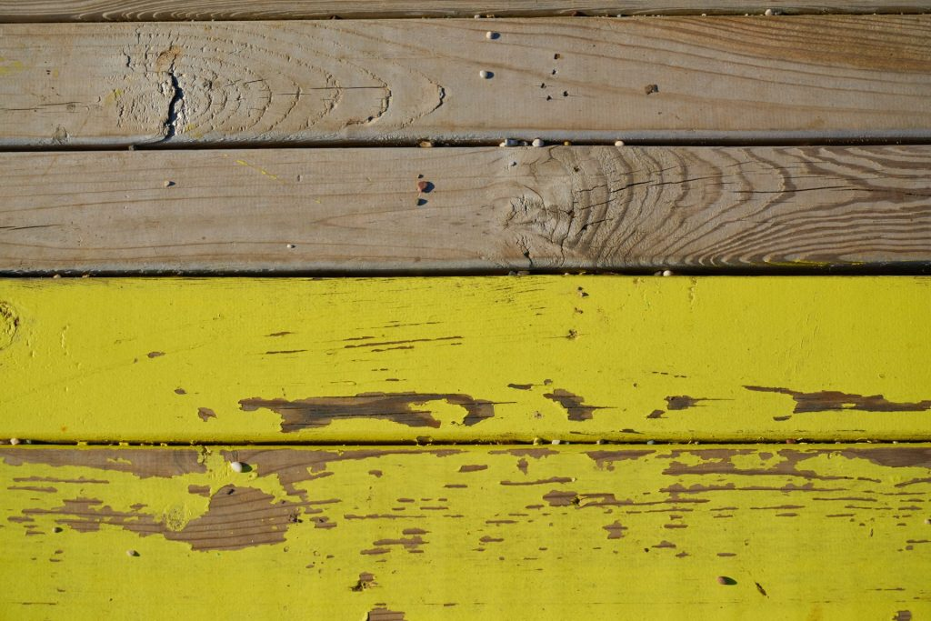 paint peeling from wood surface