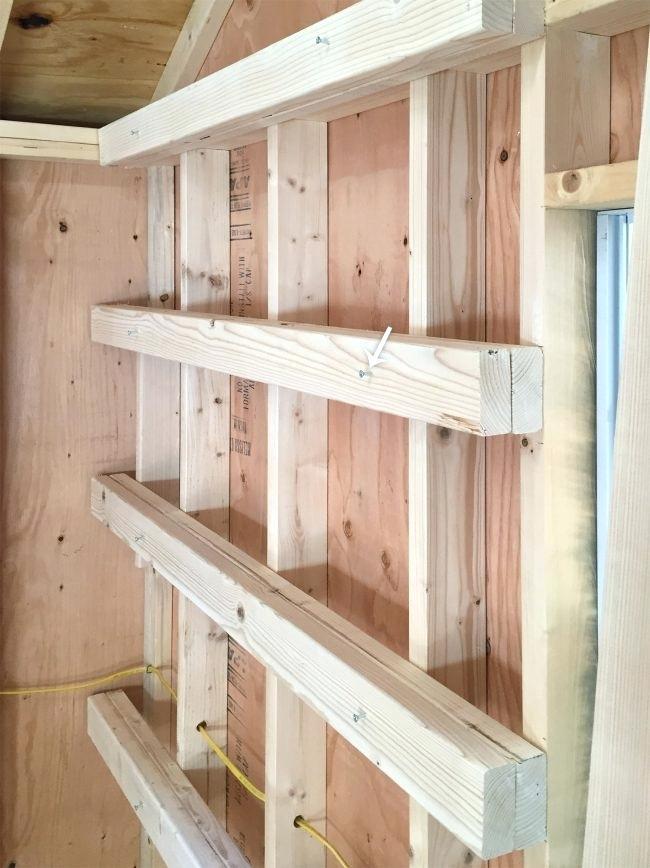 stud walls garage shelf
