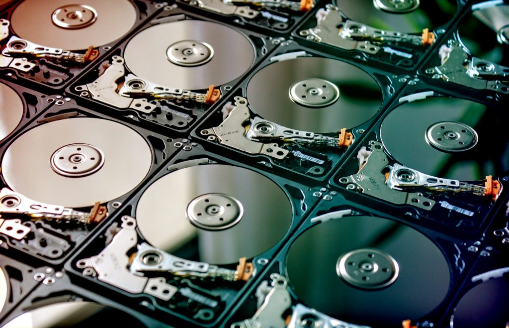 HDD Hard Drives data storage side by side with silver light color